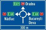 Presemnalizarea direcțiilor într-o intersecție cu sens giratoriu